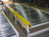 Power roller skid conveyor