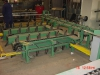 Threaded rod indexing conveyor